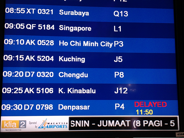 Flight information showing flight to Denpasar, Bali, is delayed by 2 hours 20 minutes