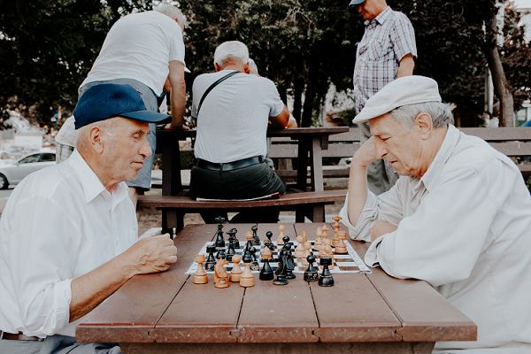 Old men playing chess in a park